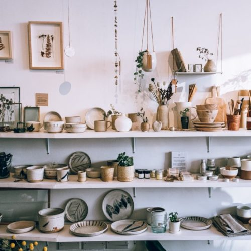 assorted-ceramics-on-wooden-shelves-3626588